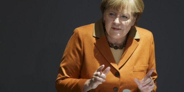 Cumbre de la UE: Merkel, Rehn, Barroso y Van Rompuy sugieren a Rajoy que pida ya el