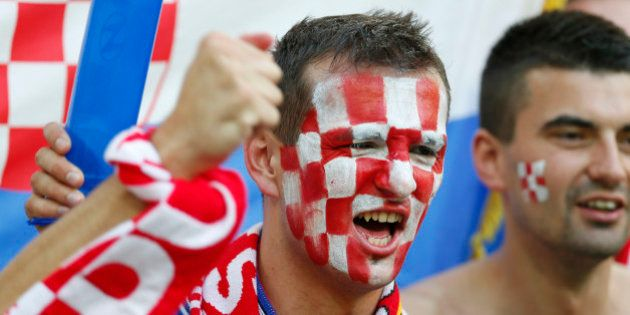 A Croatia fan cheers prior to during the Euro 2012 soccer championship Group C match between Croatia...