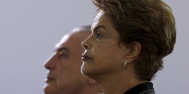 Brazil's President Dilma Rousseff (R) and Vice President Michel Temer listens to Brazil's national anthem...