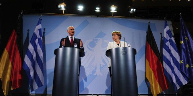 German Chancellor Angela Merkel and Greek Prime Minister George Papandreou give a statement on September...