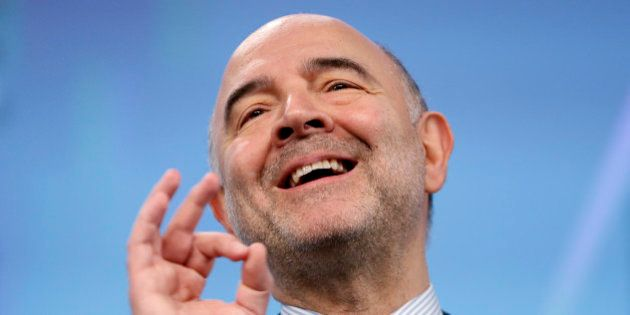 European Economic and Financial Affairs Commissioner Pierre Moscovici gestures during a news conference...