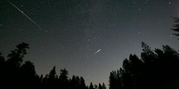 Meteors from the Perseid shower streak past stars above the Los Padres National Forest in Frazier Park,...