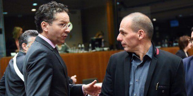 Eurogroup President and Dutch Finance Minister Jeroen Dijsselbloem (L) speaks with Greece's Finance Minister...