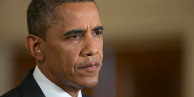 U.S. President Barack Obama listens to a question during a news conference in the East Room of the White...