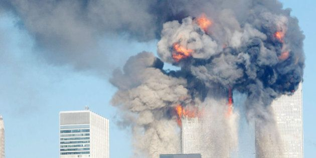 394261 112: A fiery blasts rocks the World Trade Center after being hit by two planes September 11, 2001...