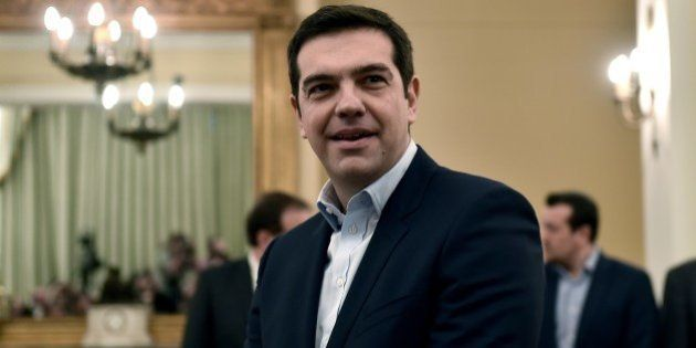 Syriza's leader Alexis Tsipras looks on as he is sworn in as Greek Prime Minister at the Presidential...