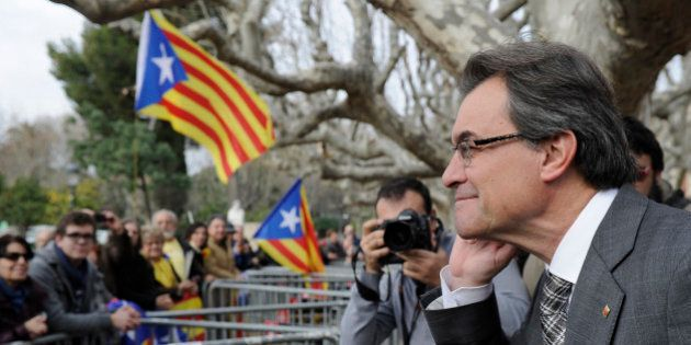 President of the Catalonian regional government Artur Mas gestures as he listens to independentist people...