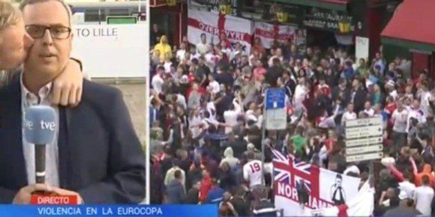 Un aficionado besa a un reportero de Televisión Española en pleno