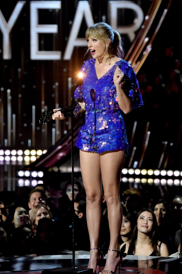 Swift speaking at the award show.