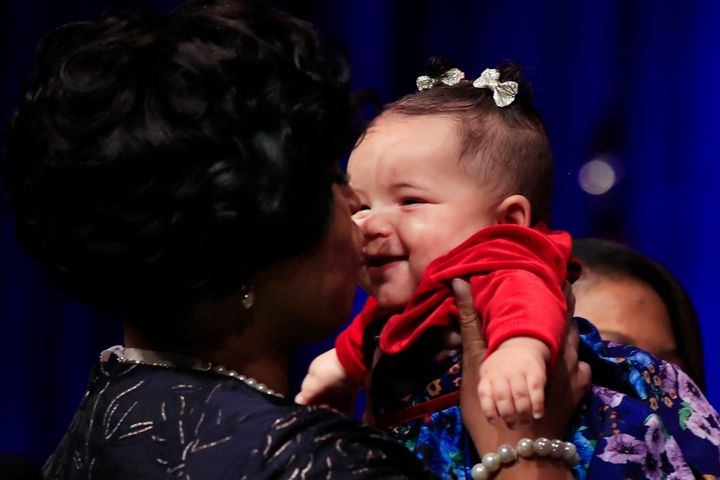 Muriel Bowser kisses her daughter, after being sworn in as mayor of the District of Columbia, Jan. 2, 2019.
