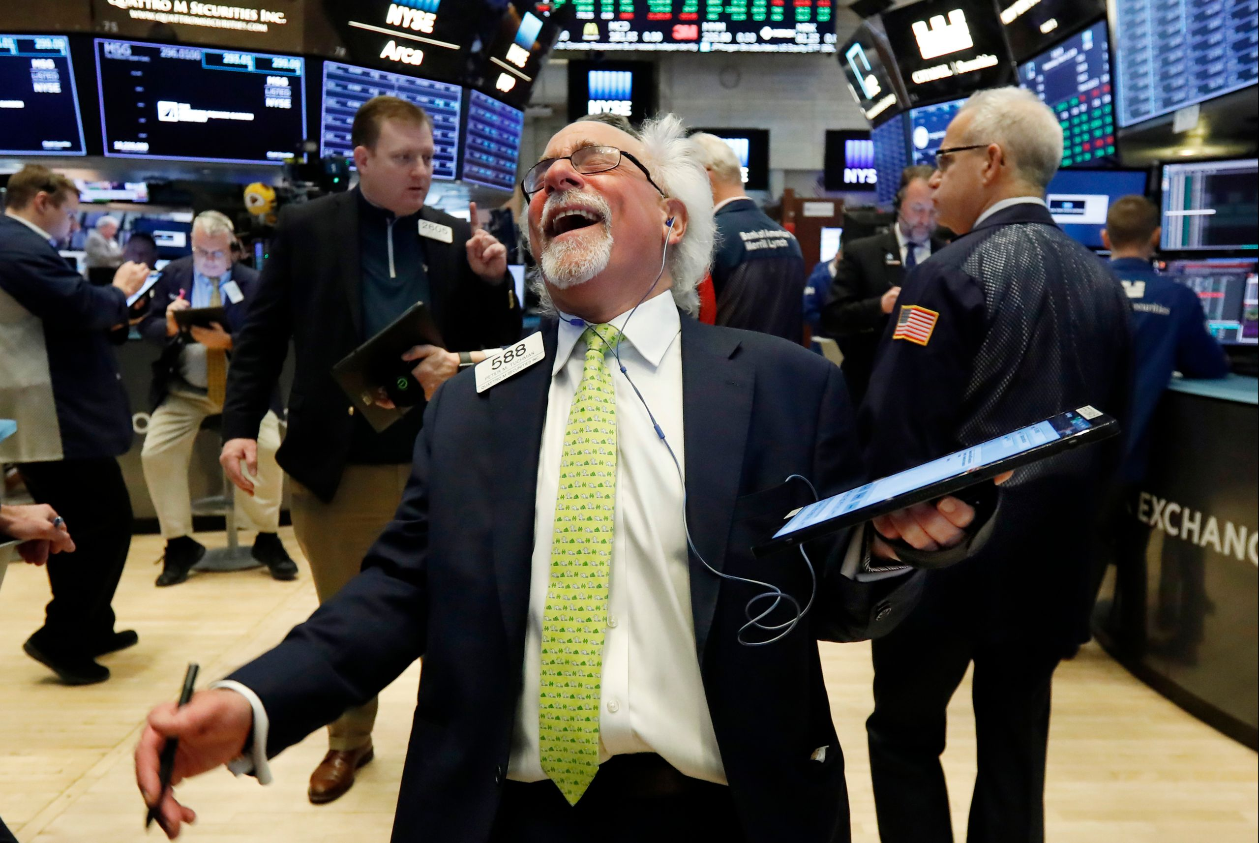 Trader Peter Tuchman laughs as he works on the floor of the New York Stock Exchange on March 13, 2019. U.S. stocks opened bro