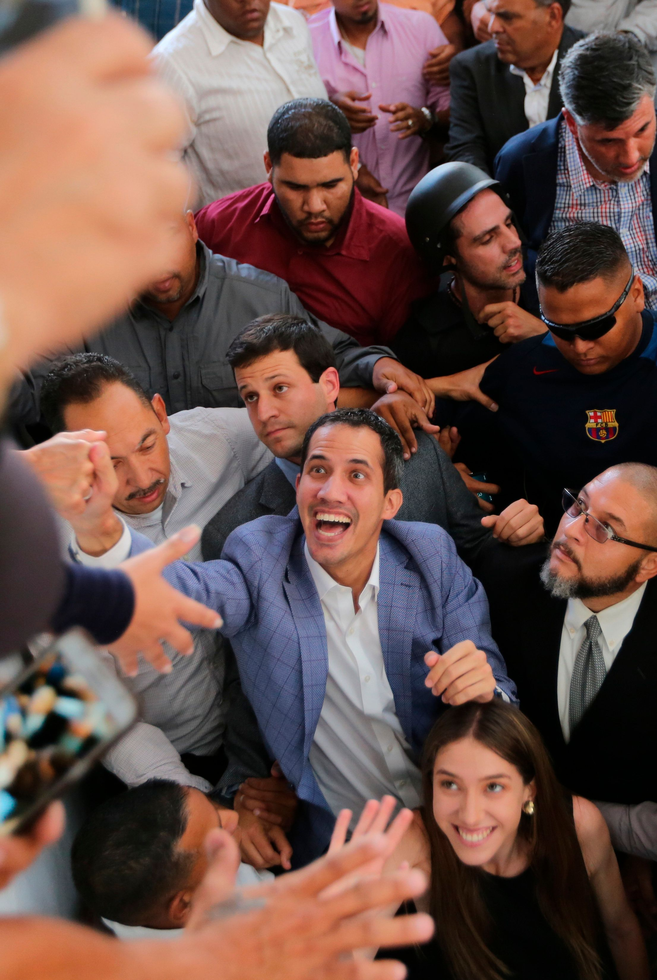 Venezuelan National Assembly President Juan Guaidó greets supporters in the Hatillo municipality of Caracas, Venezuela