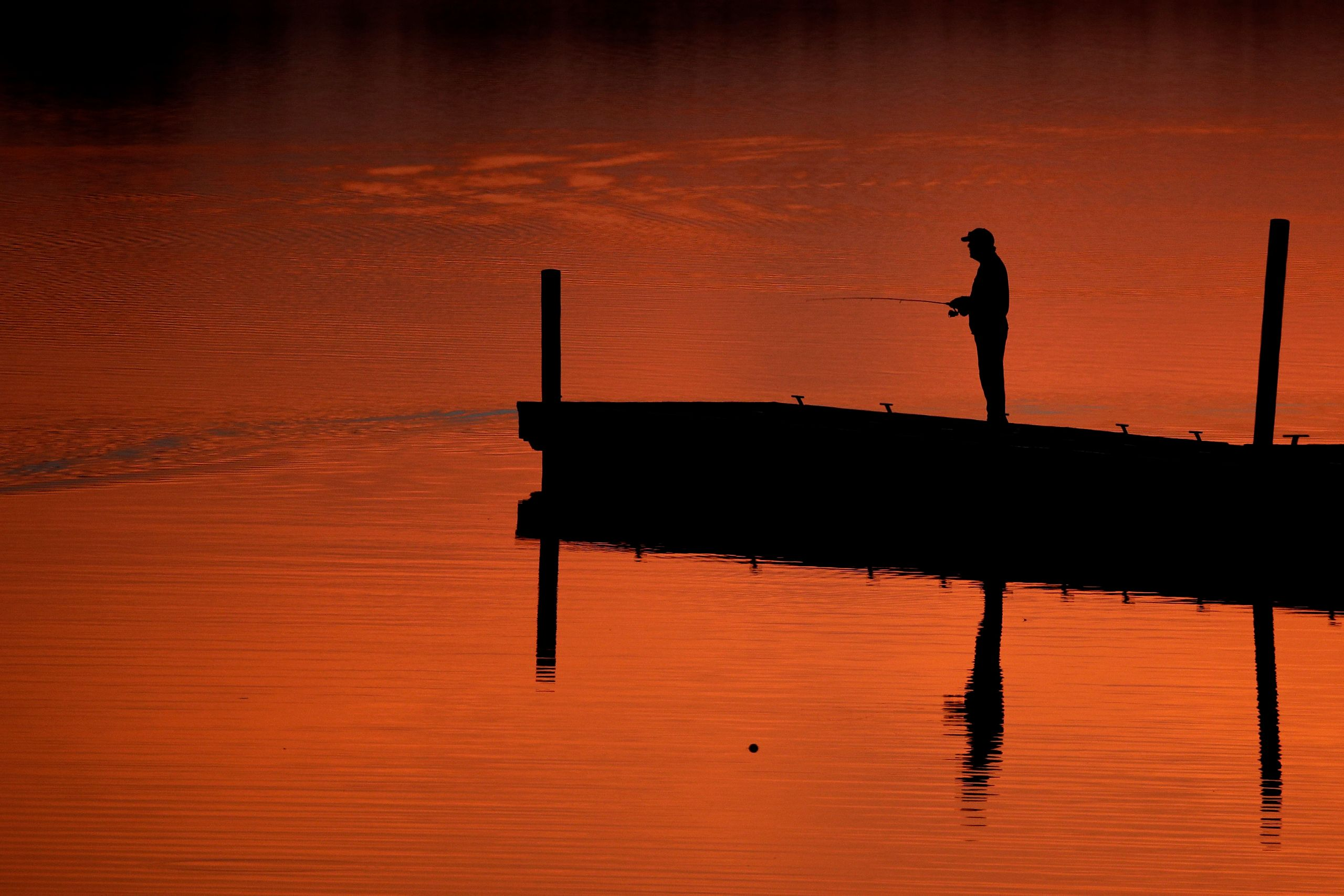 A man fishes on a dock at Shawnee Mission Park in Lenexa, Kansas, on March 11, 2019.