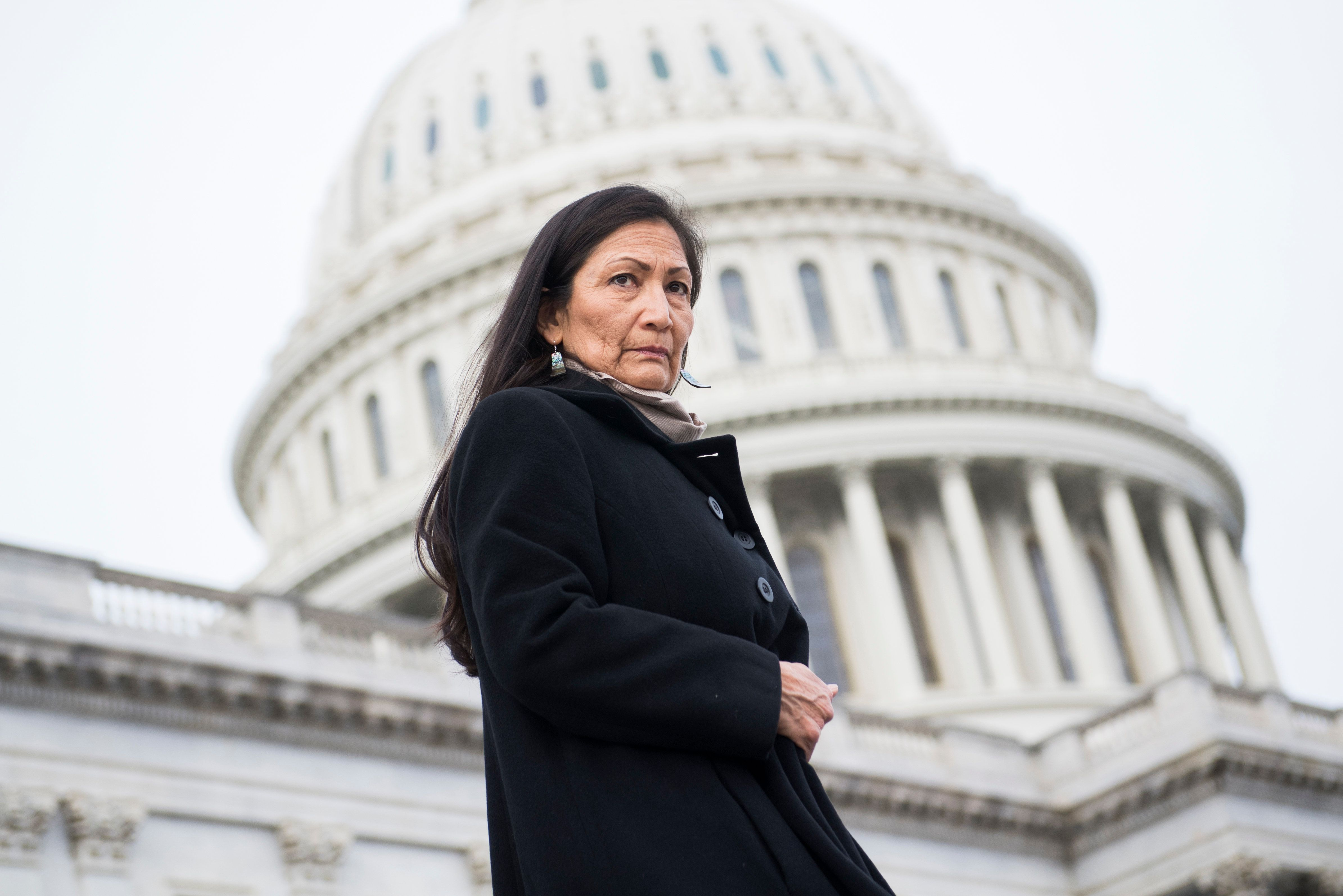 UNITED STATES - JANUARY 04: Rep. Deb Haaland, D-N.M., makes her way to a group photo with Democratic women members of the House on the East Front of the Capitol on January 4, 2019. (Photo By Tom Williams/CQ Roll Call)