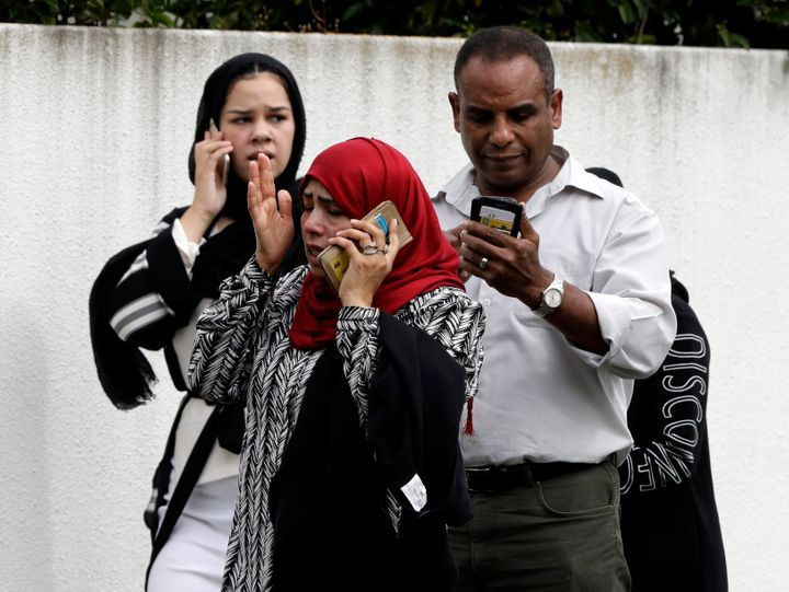 """People wait outside a mosque in central Christchurch, New Zealand, on Friday. Multiple people were killed in mass shootings at two mosques full of worshippers attending Friday prayers on what the prime minister called """"one of New Zealand's darkest days."""""""