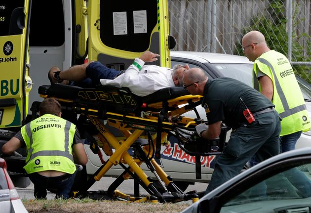 Ambulance staff take a man from outside a mosque in central Christchurch, New Zealand, on