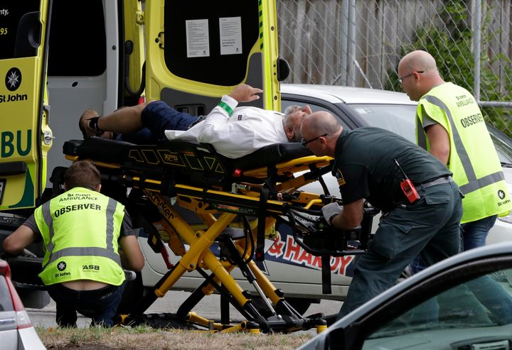 Ambulance staff take a man from outside a mosque in central Christchurch, New Zealand, on Friday.
