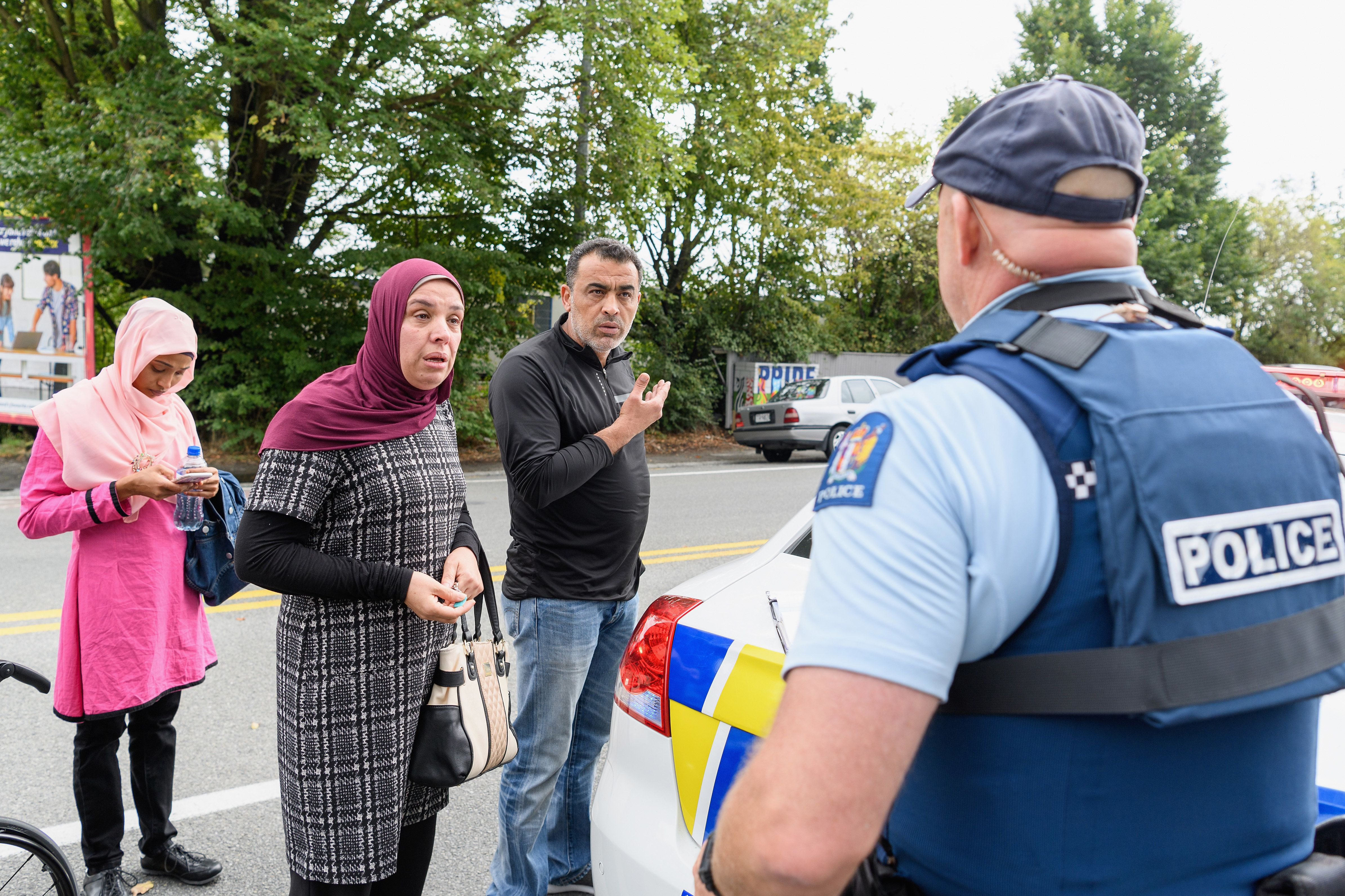 CHRISTCHURCH, NEW ZEALAND - MARCH 15: Members of the public react in front of the Masjd Al Noor Mosque as they fear for their relatives on March 15, 2019 in Christchurch, New Zealand. 49 people have been confirmed dead and more than 20 are injured following attacks at two mosques in Christchurch. Four people are in custody following shootings at Al Noor mosque on Dean's Road and the Linwood Masjid in Christchurch. Mosques across New Zealand have been closed and police are urging people not to attend Friday prayers as a safety precaution. (Photo by Kai Schwoerer/Getty Images)