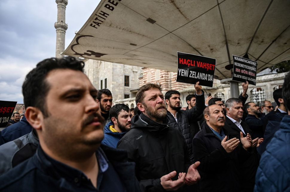 Protesters demonstrate to denounce the New Zealand mosque attacks at the Fatih mosque in Istanbul, after a symbolic funeral p