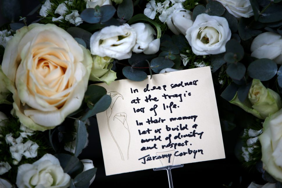 A floral tribute with a card placed by Britain's opposition Labour Party leader Jeremy Corbyn is seen outside New Zealand Hou