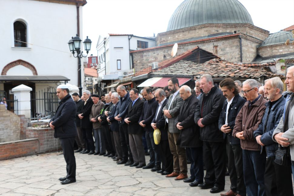 People perform funeral prayer in absentia for those who lost their lives during twin terror attacks in New Zealand mosques in