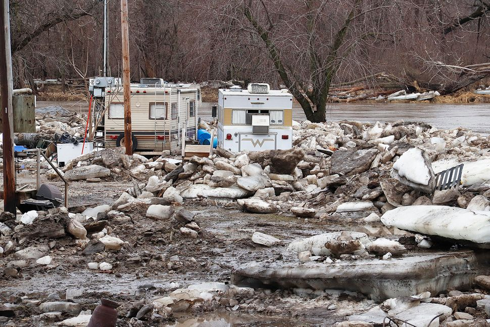 An ice jam built up on the Des Moines River at Ottumwa, Iowa, on Monday, March 12, 2019, and the damage was still evident a d