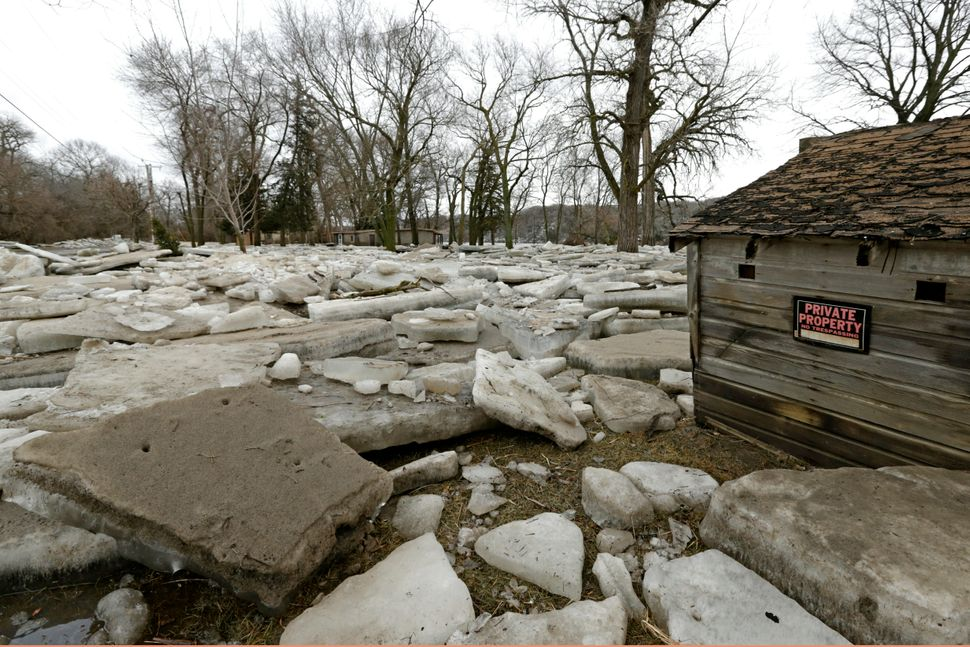 Thick slabs of ice slabs surround a structure in Fremont, Nebraska, Thursday, March 14, 2019, after the ice-covered Platte Ri