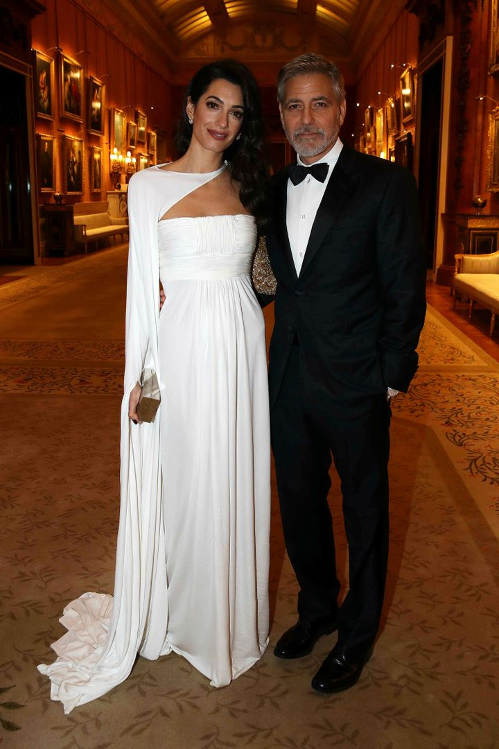 Amal and George Clooney assist a dinner to celebrate The Prince's Belief, hosted by Prince Charles, at Buckingham Palace on Ma