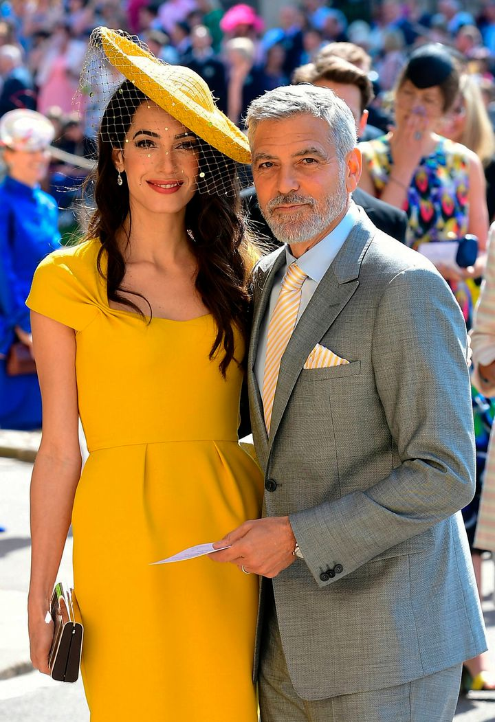 Amal and George Clooney pose collectively on the day of the royal wedding at St George's Chapel, Windsor Fortress, in Windsor, on M