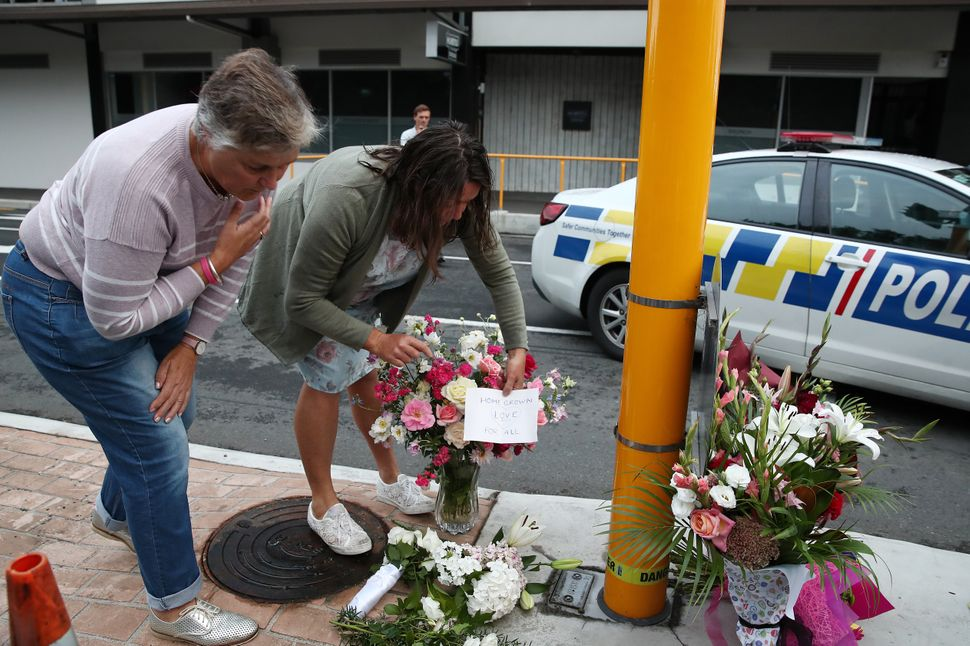 Local residents leave floral tributes at Deans Avenue near the Al Noor Mosque in Christchurch, New Zealand.