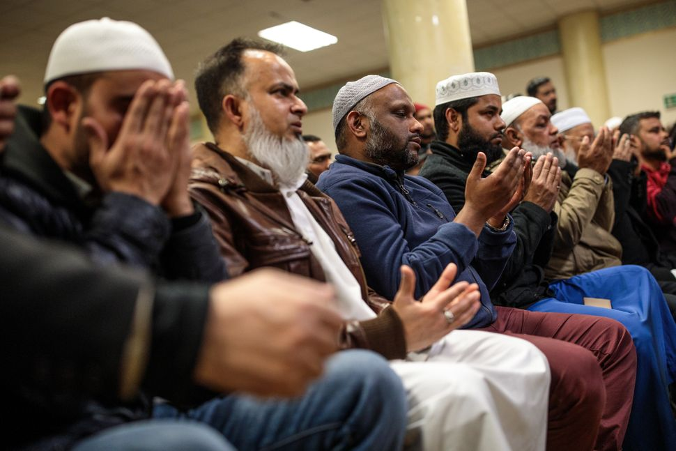 Muslims attend a vigil at the East London Mosque for the victims of the New Zealand mosque attacks.