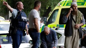 Police attempt to clear people from outside a mosque in central Christchurch, New Zealand, Friday, March 15, 2019. Many people were killed in a mass shooting at a mosque in the New Zealand city of Christchurch on Friday, a witness said. Police have not yet described the scale of the shooting but urged people in central Christchurch to stay indoors.(AP Photo/Mark Baker)