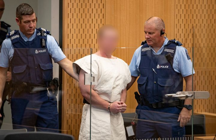 Brenton Tarrant, charged in relation to the Christchurch massacre, is escorted in the courtroom Saturday in Christchurch, New