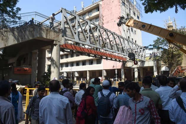The foot overbridge being dismantled by the