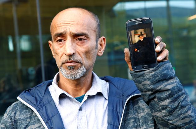 Omar Nabi speaks to the media about losing his father Haji Daoud in the mosque attacks, at the district...