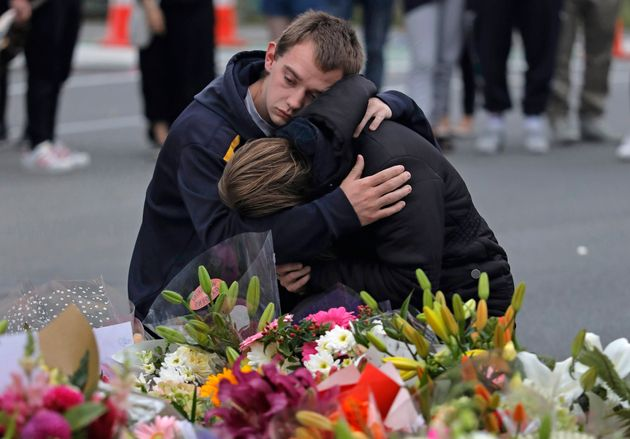 Mourners pay their respects at a makeshift memorial near the Masjid Al Noor mosque in Christchurch, New...