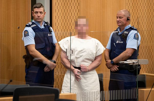 The suspect made a sign to the camera during his appearance in the Christchurch District Court on