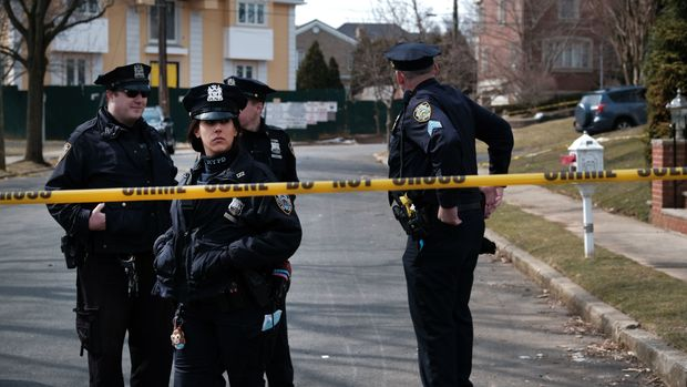 """NEW YORK, NEW YORK - MARCH 14: Police stand along the street where reputed mob boss Francesco """"Franky Boy"""" Cali lived and was gunned down on March 14, 2019 in the Todt Hill neighborhood of the Staten Island borough of New York City. Cali, 53, was a top leader of New York's notorious Gambino crime family, according to federal prosecutors. He was shot and killed Wednesday by an unidentified assailant just after 9 p.m., according to police. (Photo by Spencer Platt/Getty Images)"""