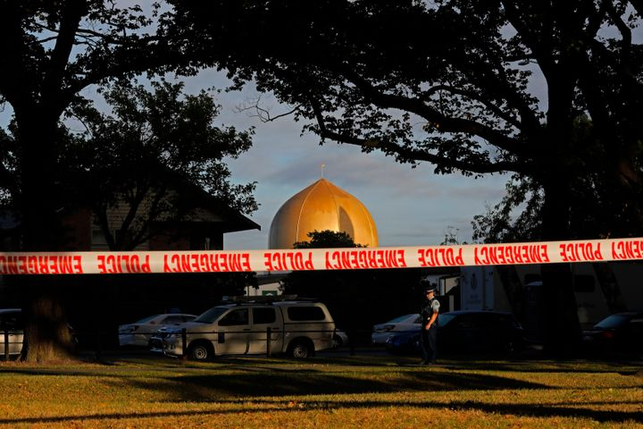 A police officer stands guard in front of the Masjid Al Noor mosque in Christchurch, New Zealand, Sunday, March 17, 2019, whe