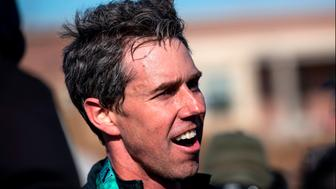 Democratic presidential candidate Beto O'Rourke speaks with media after finishing the Lucky Run 5k race on March 16, 2019 in North Liberty, Iowa. - O'Rourke has been visiting towns and cities in eastern Iowa this weekend to start his campaign. (Photo by STEPHEN MATUREN / AFP)        (Photo credit should read STEPHEN MATUREN/AFP/Getty Images)