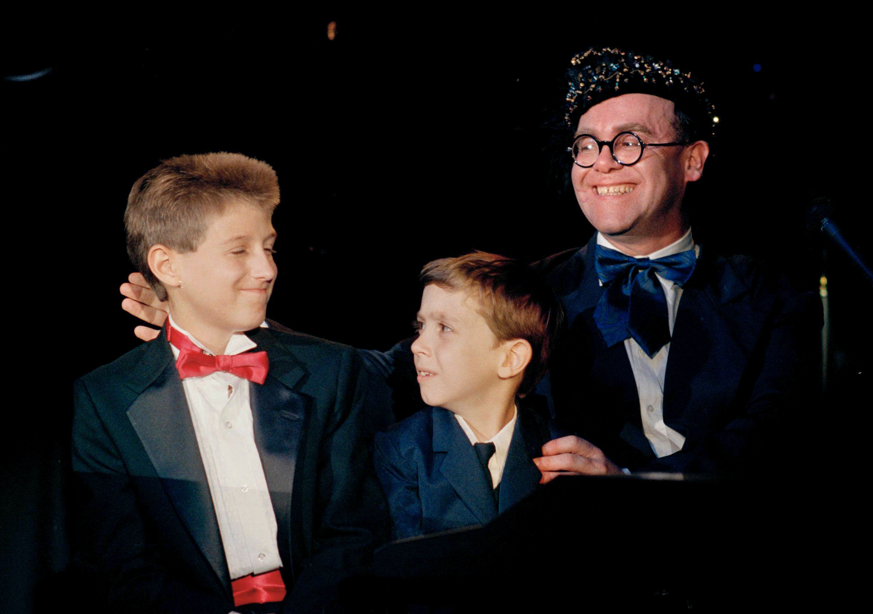 """AIDS activist Ryan White is seen far left of British pop singer Elton John at the """"For the Love of Children"""" benefit for children with AIDS and other serious illnesses in Los Angeles in 1988."""