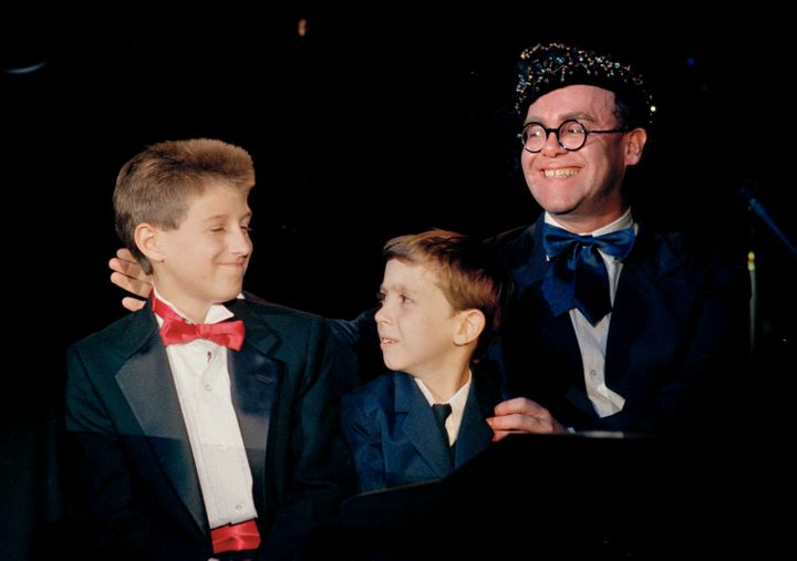 "AIDS activist Ryan White is seen far left of British pop singer Elton John at the ""For the Love of Children"" benefit for chil"