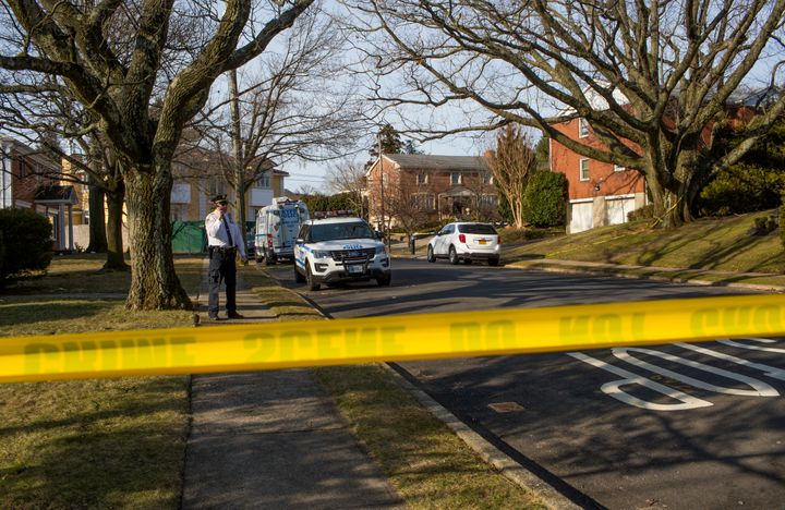 Police watch over the crime scene of the home of alleged Gambino family mafia crime boss Frank Cali following his shooting de