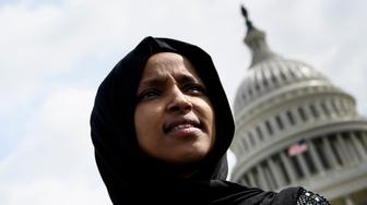 US Representative Ilhan Omar attends a youth climate rally on the west front of the US Capitol on March 15, 2019 in Washington, DC. (Photo by Brendan Smialowski / AFP)        (Photo credit should read BRENDAN SMIALOWSKI/AFP/Getty Images)