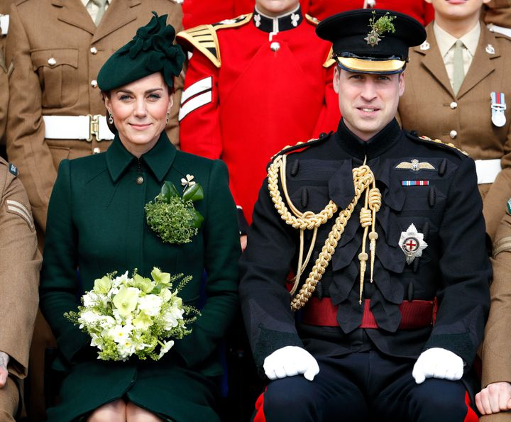 The Duke and Duchess of Cambridge posing for a regiment photo.