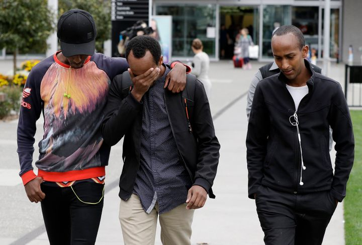 Mucad's elder brothers Abdifatah Ibrahim (center) and Abdi Ibrahim (right) with an unidentified friend in Christchurch, March
