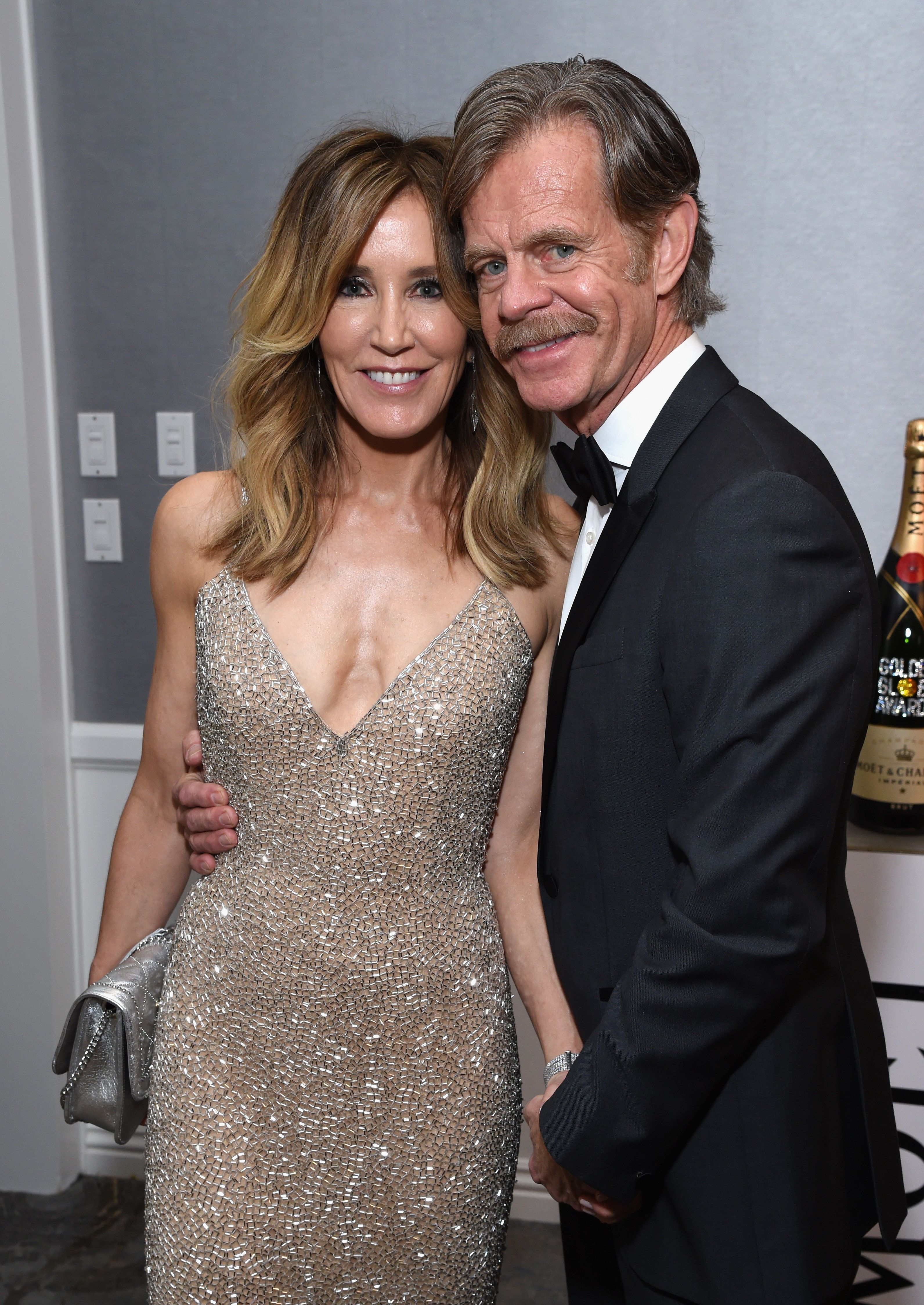 BEVERLY HILLS, CA - JANUARY 06:  Felicity Huffman and William H. Macy attend Moet & Chandon at The 76th Annual Golden Globe Awards at The Beverly Hilton Hotel on January 6, 2019 in Beverly Hills, California.  (Photo by Michael Kovac/Getty Images for Moet & Chandon)