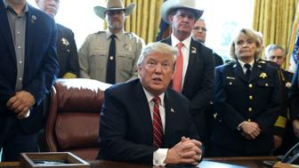 In this March 15, 2019, photo, President Donald Trump speaks about border security in the Oval Office of the White House, Friday, March 15, 2019, in Washington. Trump's veto of a bipartisan congressional resolution rejecting his border emergency declaration is more than a milestone. It signals a new era of tenser relations between the two ends of Pennsylvania Avenue. (AP Photo/Evan Vucci)