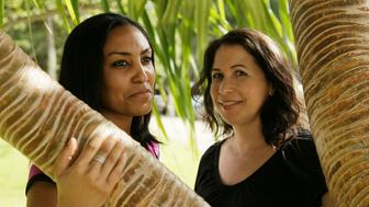 FILE - In this Dec. 19, 2011 file photo, Taeko Bufford, left, and Diane Cervelli pose for a photo near Waikiki beach in Honolulu. A Hawaii appeals court ruling that a bed and breakfast discriminated against a couple by denying a room to two women because they're gay will stand after the state's high court declined to take up the case. The Hawaii Supreme Court on Tuesday, July 10, 2018, rejected Phyllis Young's appeal of a lower court ruling that ordered her to stop discriminating against same-sex couples. (AP Photo/Eric Risberg, File)