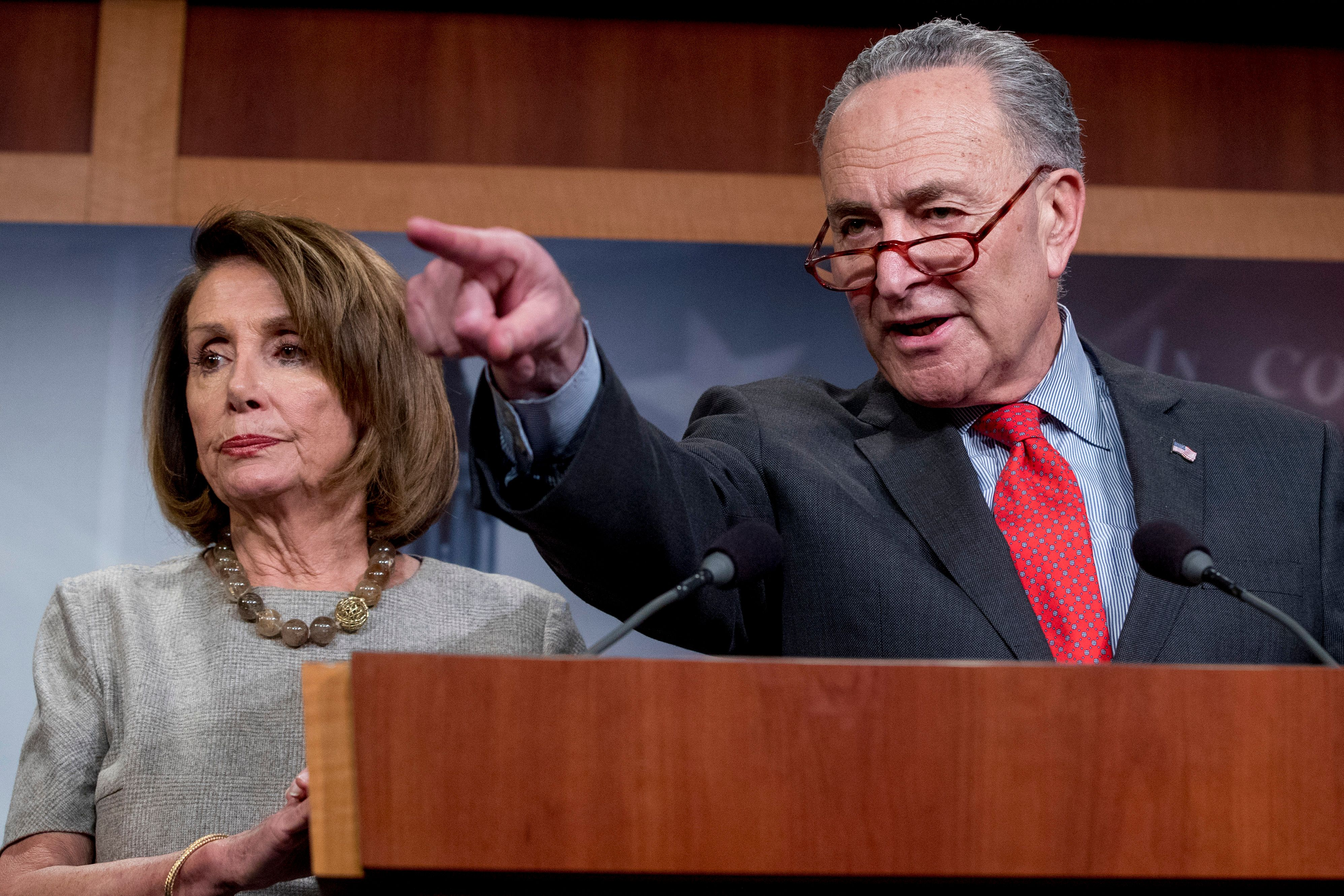 Senate Minority Leader Sen. Chuck Schumer of N.Y., accompanied by Speaker Nancy Pelosi of Calif., left, calls on a reporter during a news conference on Capitol Hill in Washington, Friday, Jan. 25, 2019, after President Donald Trump announces a deal to reopen the government for three weeks. (AP Photo/Andrew Harnik)